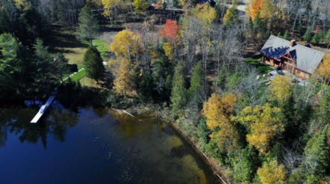 An aerial view of the lakeside Escape home with the estate's nearby Club House and swimming dock - Escape - Mont Tremblant - rentals