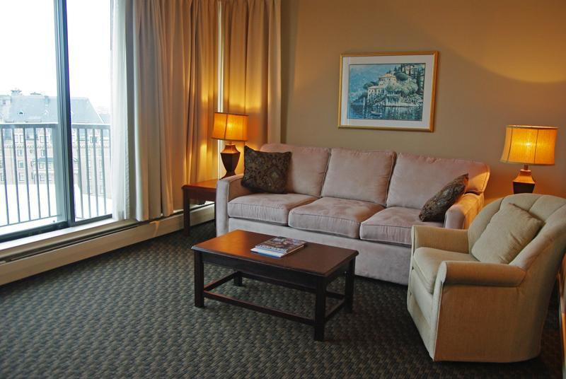 Living room with Queen fold-out sofa bed, desk and balcony - Downtown Victoria One Bedroom Suite - Victoria - rentals