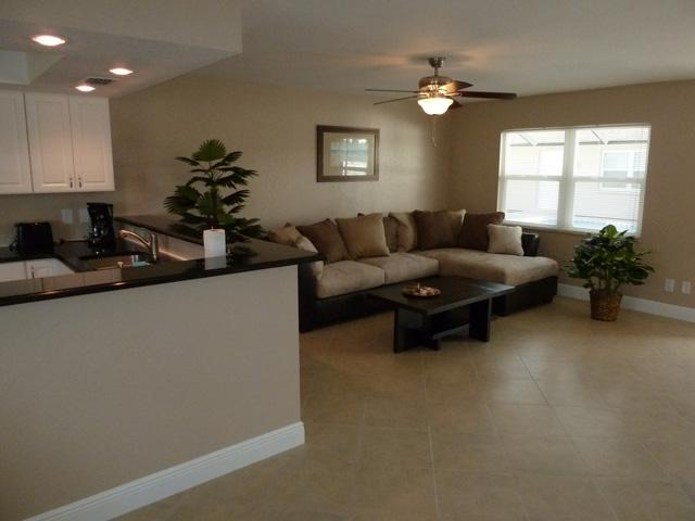 Spacious Living room with open floor plan - Lakeside Villas, luxury on a budget, tile, granite - Cape Coral - rentals