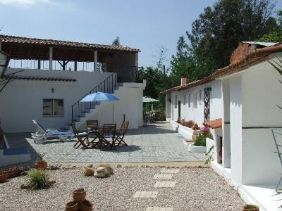 Courtyard with cottage on right, house on left - Tranquil, spacious cottage next to forest - Miranda do Corvo - rentals