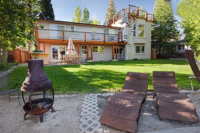Waterfront Tahoe Keys Yard BBQ, Mountain View Deck and Outdoor Fireplace and Beach.  - Waterfront Tahoe Keys Home, Hot tub, Boat Dock. - South Lake Tahoe - rentals