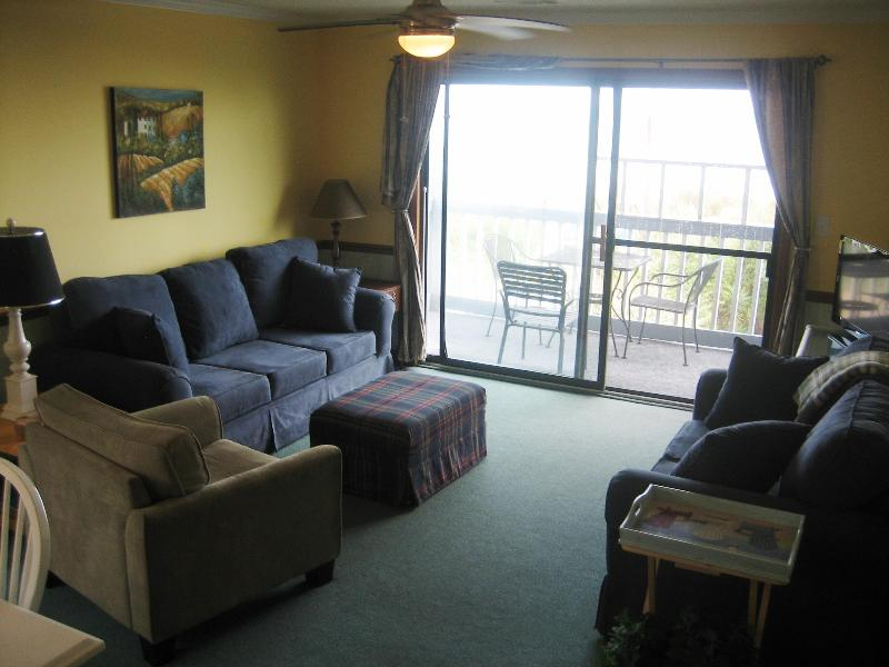 Spacious living room with ocean views - Sounds of the sea 3 bedroom oceanfront condo - Surfside Beach - rentals