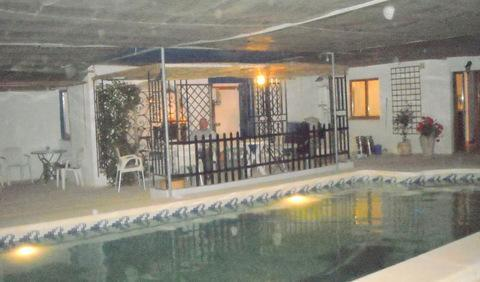 Poolside bar at night - Las Golondrinas B&B. Country guest house with pool - Fuente alamo de Murcia - rentals