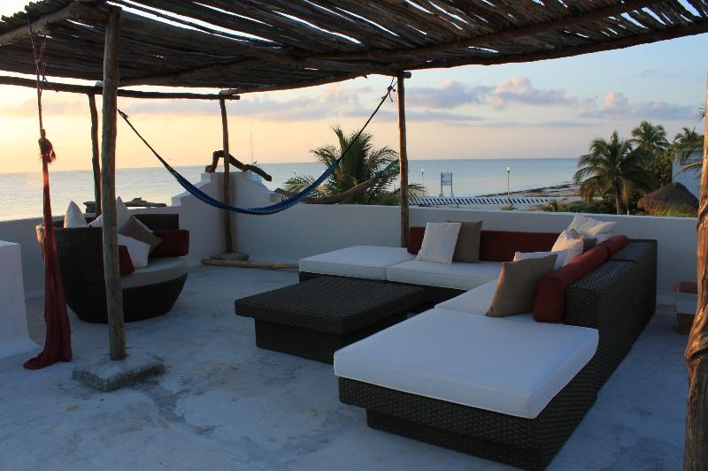 Beautiful sunrise on the private terrace. - Oceanfront Luxury 2 / 2 Condo with Pool - Puerto Morelos - rentals
