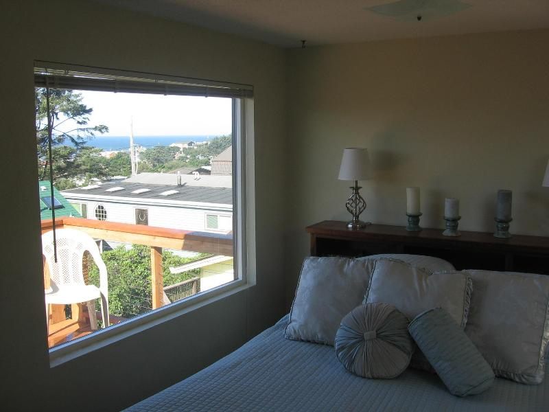 Upstairs bedroom with queen bed, ocean view, and private deck.  Bathroom off master bedroom. - Betty's Beach Bungalow - Lincoln City - rentals