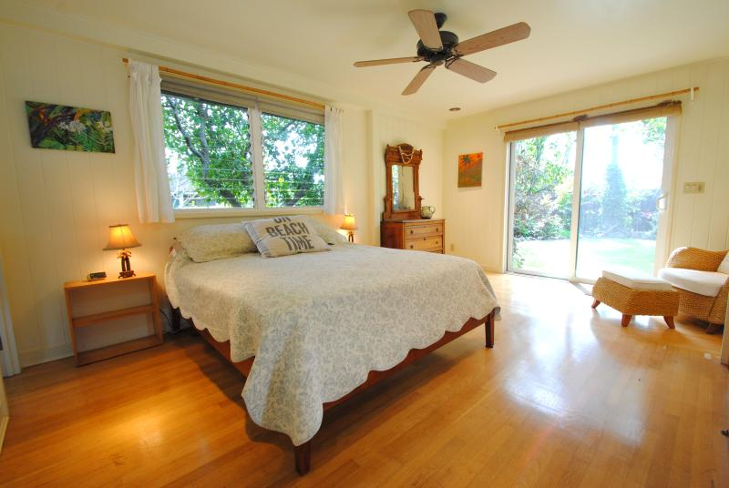 Roomy master bedroom with sliding door opening up to backyard - Charming Beach House, Walk to the beach! - Paia - rentals