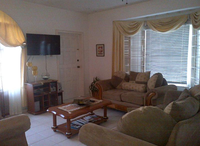 comfortable living room, flatscreen tv - Spacious 2 bedroom Condo with View - Ocho Rios - rentals