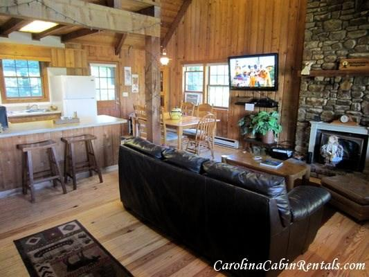 Laurel Chase Great Room with pull out leather sleeper sofa by stone fireplace and large flat screen TV - Laurel Chase - Blowing Rock - rentals