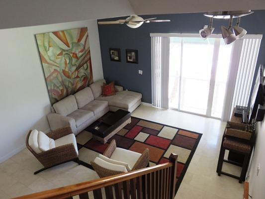 Living Area with 50 inch HDTV and Balcony - South Beach Chic /  Steps from the Sand! - Miami Beach - rentals