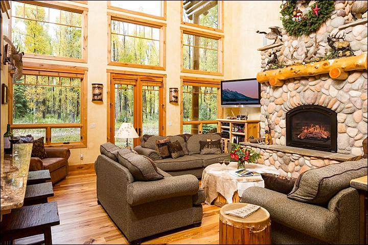 Open Living Room Boasts Wood and Stone Finishes and Wonderful Forest Views - Expansive Mountain Home - Steps from the Snake River (6961) - Wilson - rentals
