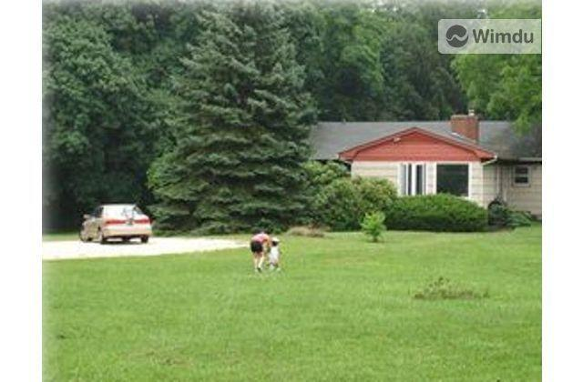 Front lawn of ranch house on 3.5 acres - Lovely Long Island Home on 3 acres -Close to Beach - Saint James - rentals
