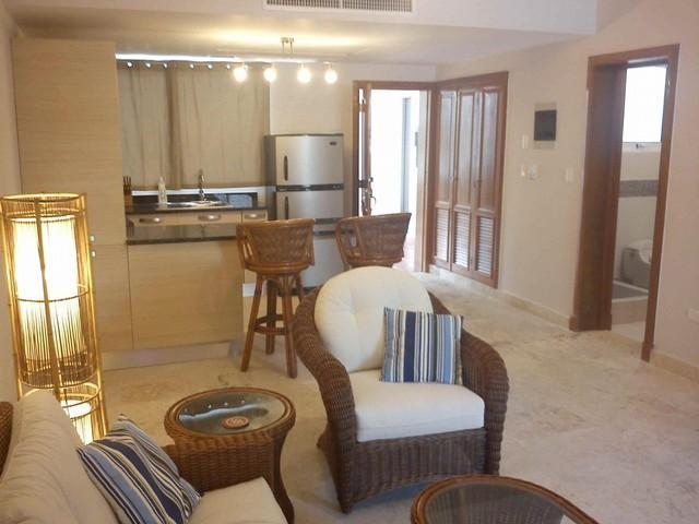 living room    bar in background - Beachfront 1 BR condo in Playa Turquesa - Punta Cana - rentals