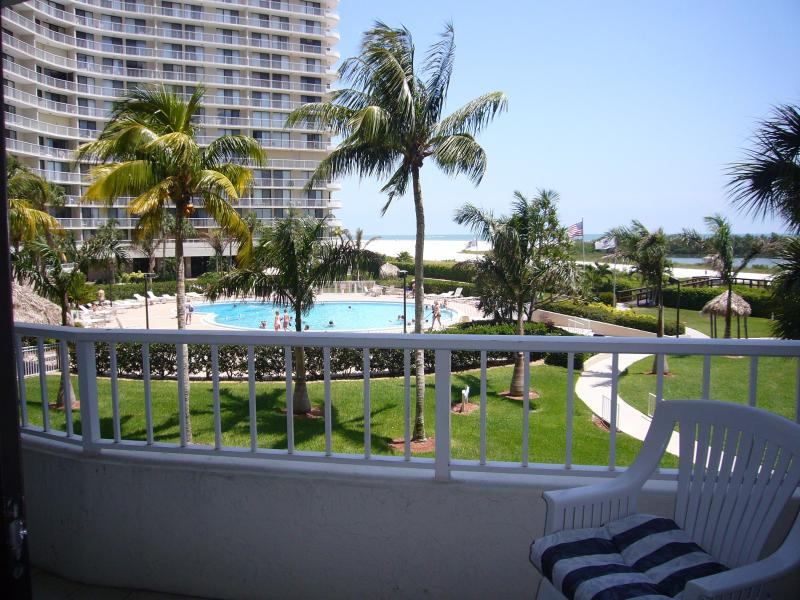 Pool and Beach view from balcony - Lovely Marco Beachfront Condo  w/Southern Exposure - Marco Island - rentals