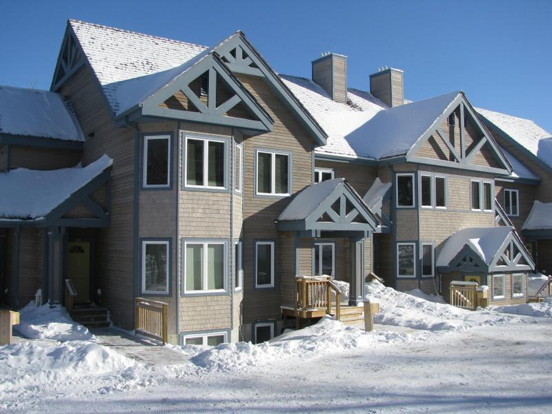 Piste at left hand side of picture - steps from front door - 2 bed condo in Jay Peak Resort - Ski-in / ski-out - Jay Peak - rentals