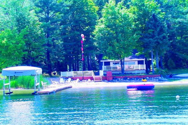 View from the lake of house, private sandy beach, 2 decks and 150' dock! - Waterfront Lake Charlevoix with 3 Boats,Dock,Decks - East Jordan - rentals
