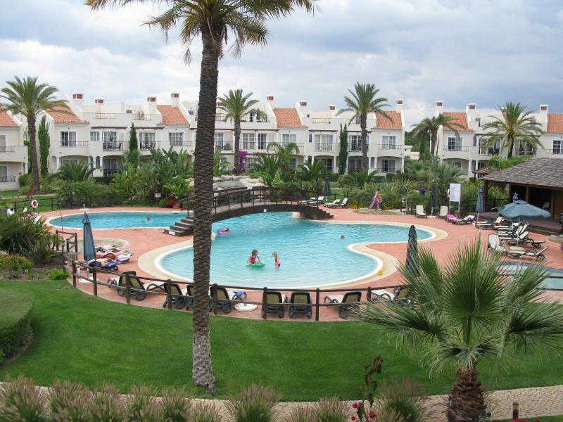 communal pool view from our terrace , literally 3 steps away - 4 bedroom luxury townhouse in golf resort,algarve - Vilamoura - rentals