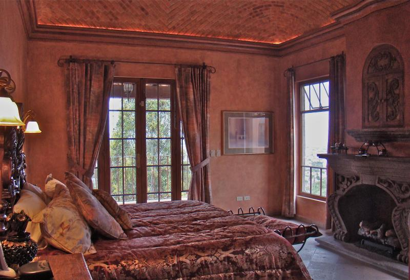 Master suite with fireplace and private balcony has  lovely view of the city  - Spectacular home in San Miguel de Allende, Mexico - San Miguel de Allende - rentals