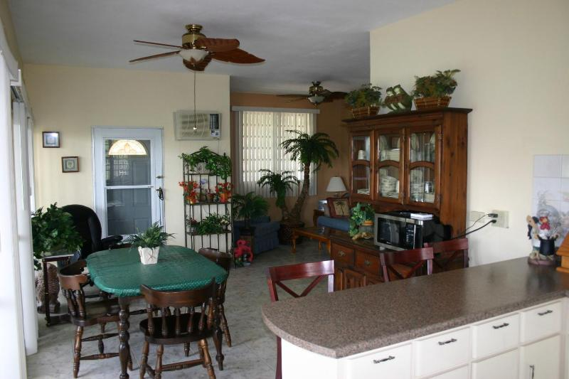 Open Kitchen and dining area with sliders to the wraparound porch and ocean views - Rincon Affordable Family Vacation Home with a View - Rincon - rentals