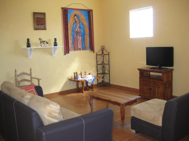 The comfortable living room graced by original painting of Guadalupe - Casa Tonantzin - San Sebastian - rentals