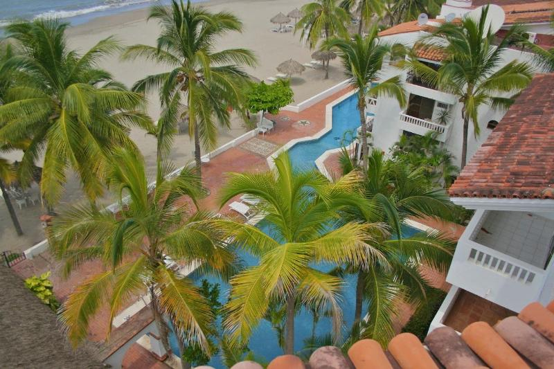 Shot of pool + beach from rooftop of Quinta Pacifica - Beautiful, Spacious Condo - Steps to Pool + Beach - Nuevo Vallarta - rentals