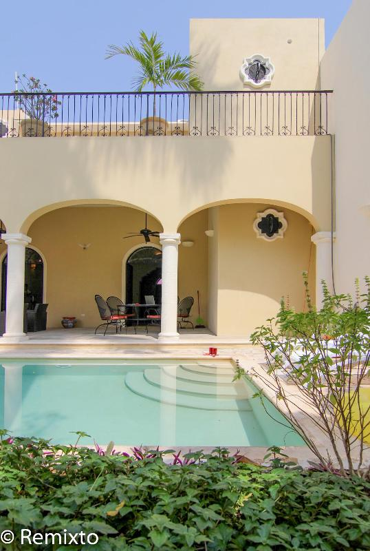 Looking from the garden to the patio and second floor terrace - Elegant Living in Historic Centro - Merida - rentals