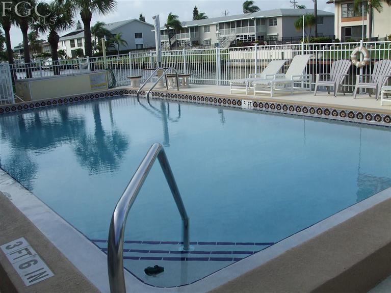 Relax and read a book while enjoying the tropical canal view at the pool - Waterfront, First Floor, End Unit, Pool, Pets ok! - Cape Coral - rentals
