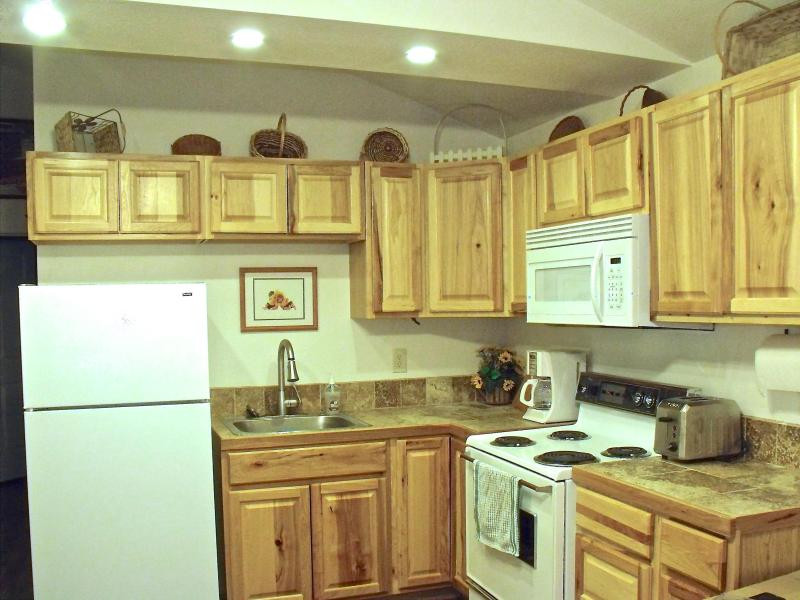 Our lovely kitchen is stocked with dishes, cookware and utensils. - Currently unavailable - Flagstaff - rentals