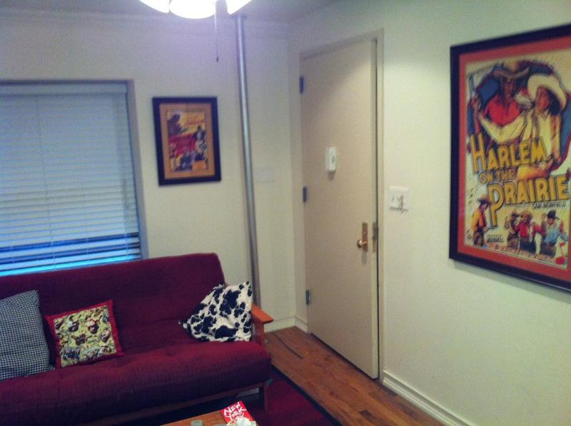 Futon in living room, opens to full bed - Harlem Brownstone Apartment - New York City - rentals