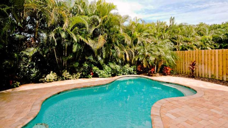 Tropically Landscaped Heated Pool - Twin Villa by the Sea: 3BR/3BA Family- and Pet-Friendly Pool Home - Holmes Beach - rentals