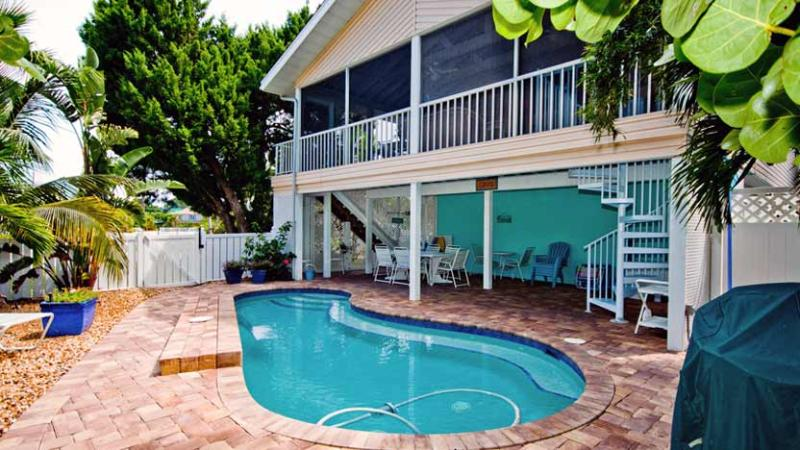 Screened Lanai/Balcony Overlooks Heated Pool - Life is Good at the Beach: 3BR/2BA Family- and Pet-Friendly Pool Home - Anna Maria - rentals