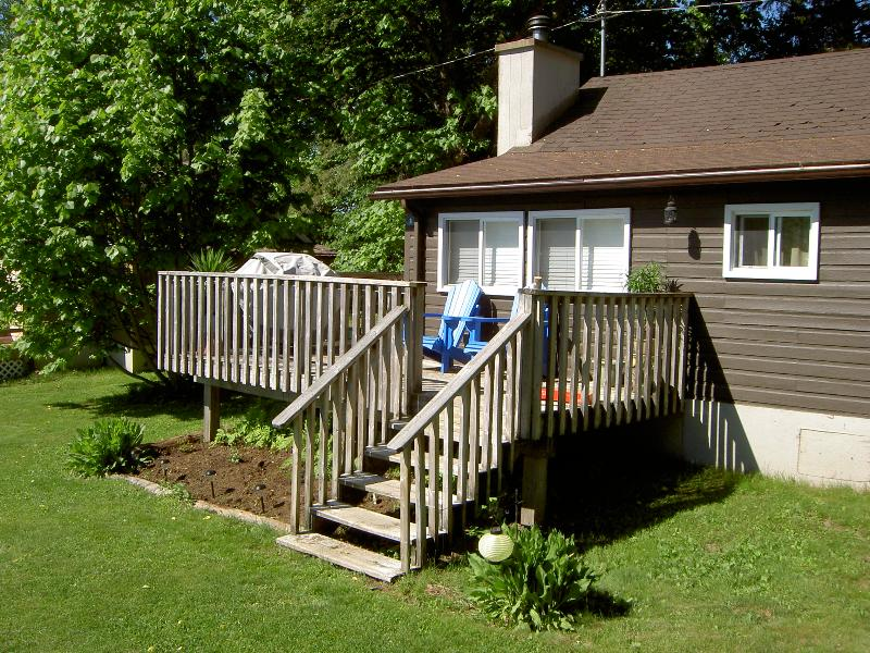 Willow Beach Cottage 2, before we sprayed the roof. We plant a garden, then it's up to the deer! - Cozy Waterview Haliburton Cottage with Fireplace - Haliburton - rentals
