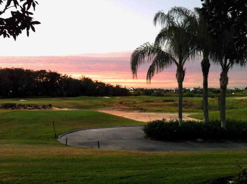 Northern facing porch showcases beautiful sunsets.  What a way to end the day! - 10 minutes to Disney:  updated, ground floor, 3 bedrm, golf front condo near pool in 5* Reunion Resort - Reunion - rentals