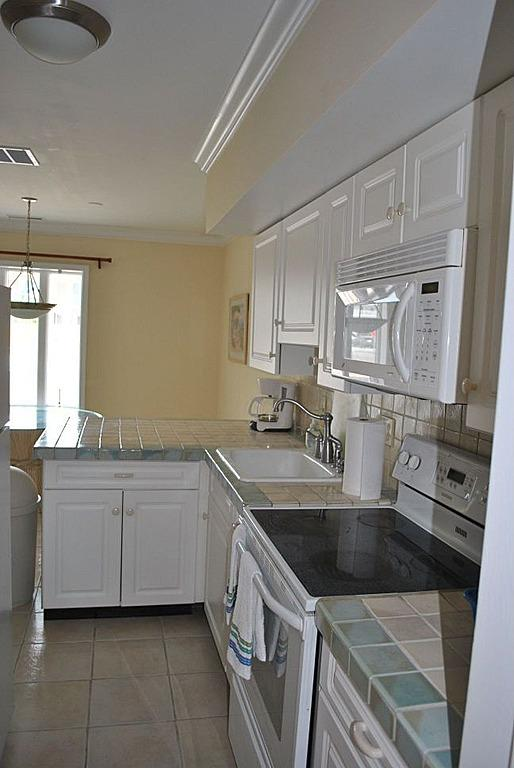 A view of the kitchen - N. Wildwood Condo sleeps 4; 400 steps to Sand! - North Wildwood - rentals
