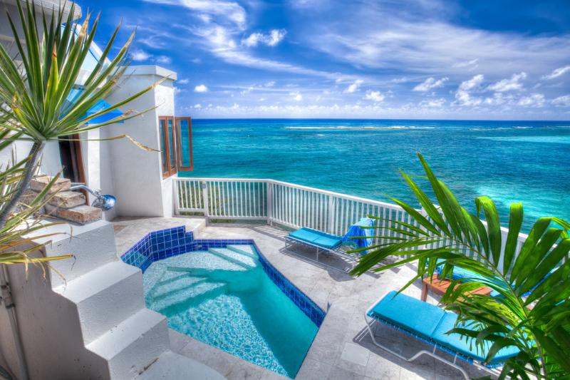 There is a plunge pool and outdoor shower adjacent to Honeymoon cottage leading to a stairway down to the beach. - WOW! Romantic Ocean Front Honeymoon Cottage & Pool - Grapetree Bay - rentals