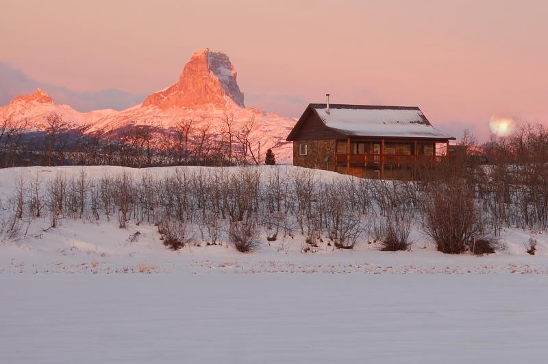 Sun Rise Full Moon Set over StoneHouse and Chief Mountain - The StoneHouse At Duck Lake - Glacier Park - Babb - rentals
