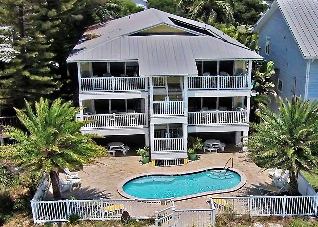 Aerial View - Sunset Villas exterior facing the Gulf of Mexico with pool beach side. - Sunset Villas Unit #4 - Redington Shores - rentals