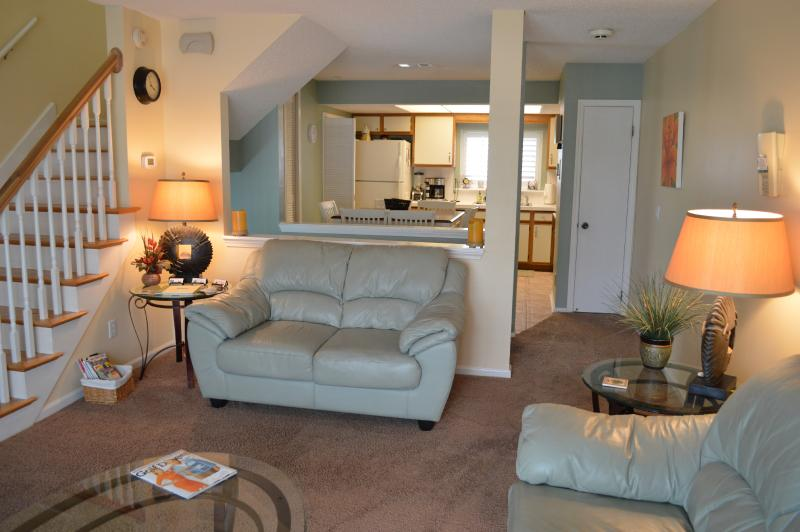 Living area is open to Kitchen on Level 2 - Cozy and Loads of Amenities- Steps to the sand! - Jacksonville Beach - rentals