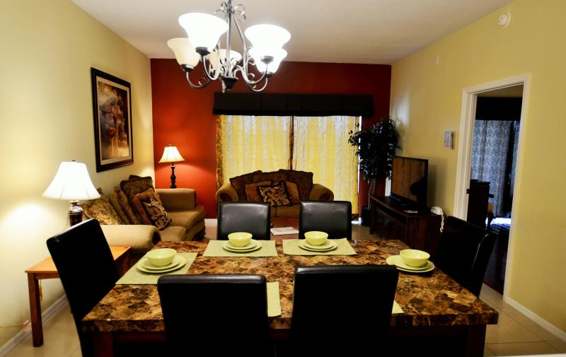 Living and dinning area - 2 miles to Disney, 4BR/3BA big Condo from $75/NT - Kissimmee - rentals