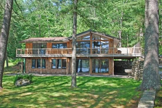 White Pines has a large deck across the rear of the home facing Megunticook Lake - WHITE PINES - Town of Camden - Megunticook Lake - Camden - rentals