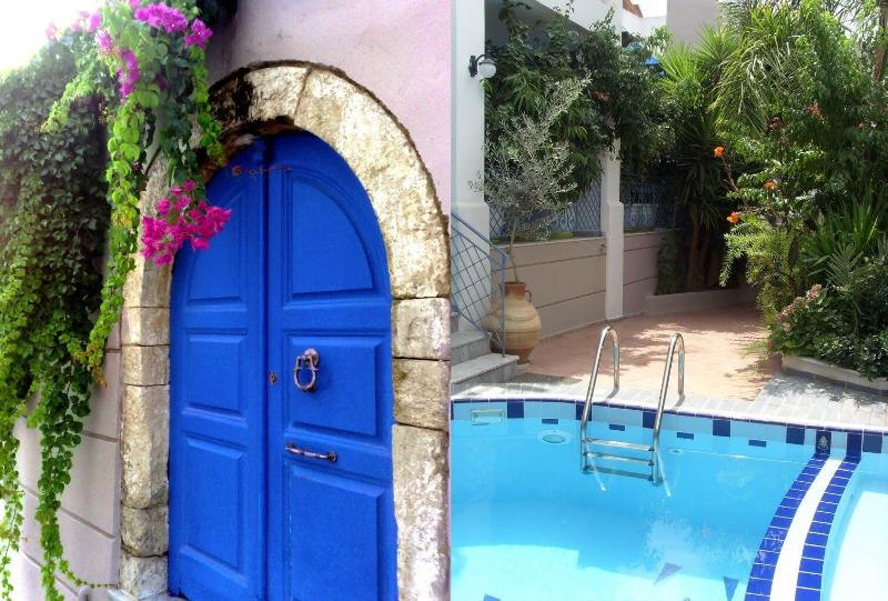 The medieval gate leads to the flower festooned courtyard - Villa Athena Kallergi - medieval village of Loutra - Rethymnon - rentals