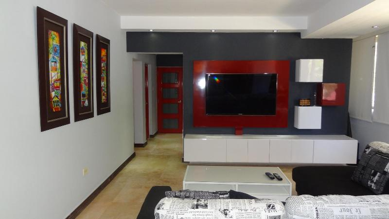 Family room and entertainment center - Recently Updated, Stylish and Beautiful 3 bedrooms & 2 Bathrooms Apartment with the Best Location - San Juan - rentals