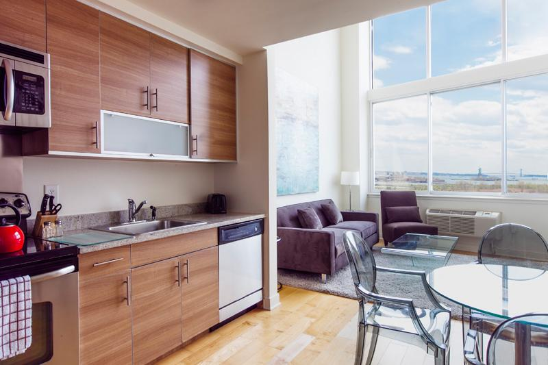 Kitchen and living room - Sky City at 9 Regent- 1 Bedroom Duplex- Statue of Liberty view ! - Jersey City - rentals