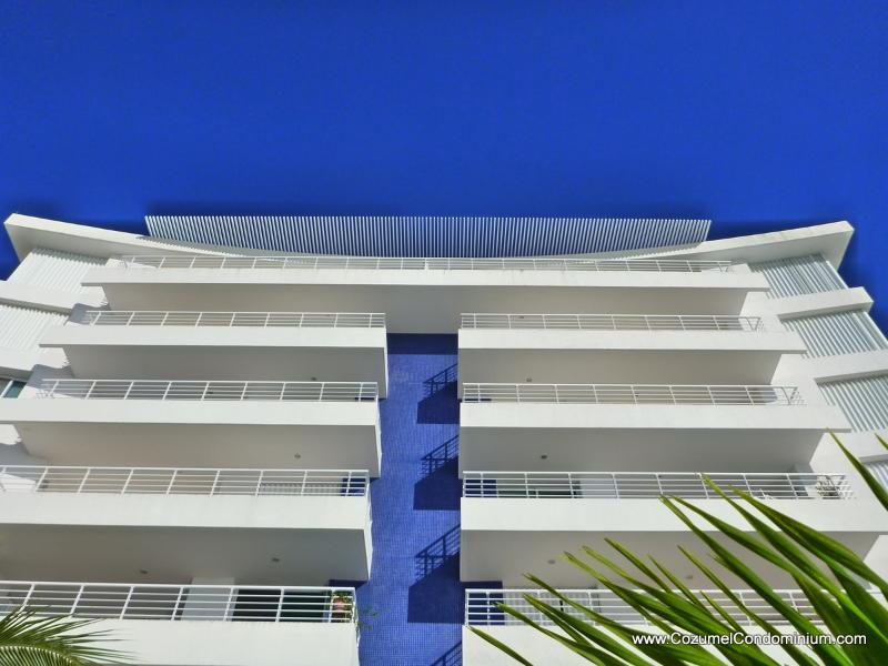 Ocean side view with full width balconies - A Luxurious Oceanfront Cozumel Condo,  Nah Ha 602 - Cozumel - rentals