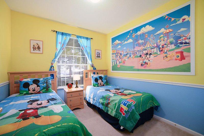 This adorable bedroom is filled with Mickey and his friends - Tropical Treasure - 3 bed Condo with 3D TV, PS3, Mickey Mural and More! - Kissimmee - rentals