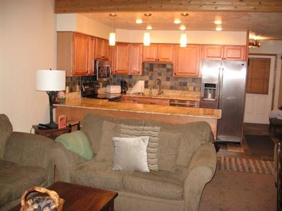 Kitchen and living room - Beautiful interior, ski in and out to Navajo Lift area, large spacious floor plan - Brian Head - rentals