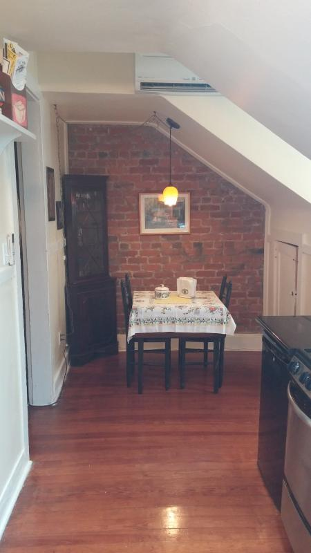 Entry way into your French Quarter home! Exposed brick and eat-in kitchen. - Our Little French Quarter Camp: charming & Cozy! - New Orleans - rentals
