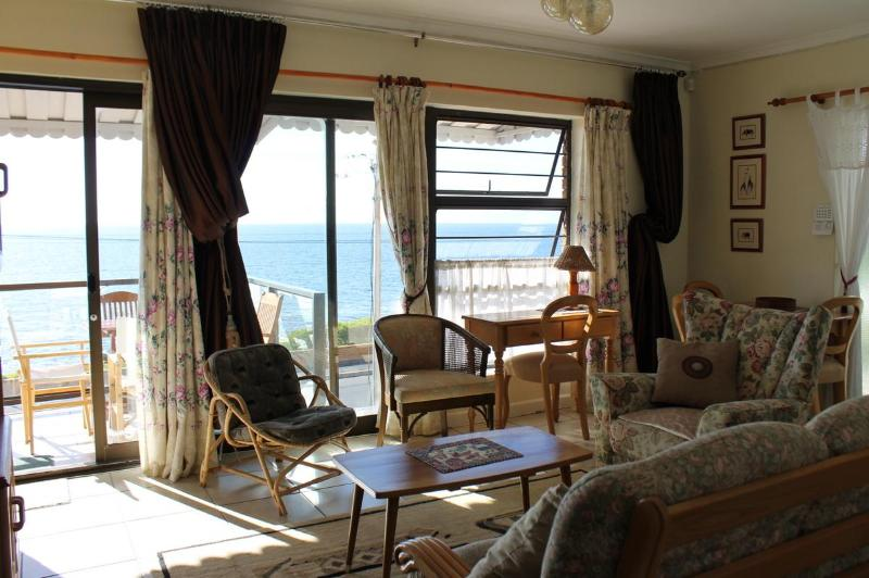 Lounge, balcony with view of False Bay - Seahorses Sea View Apartment - Fish Hoek - rentals