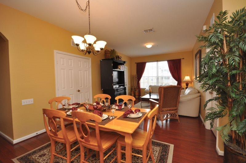 Enjoy a wonderful family dinner at this beautiful dining table - A Piece of Magic -3rd Floor Bldg 5, Beautiful Oversized 3 Bed, 2 Bath Condo! - Kissimmee - rentals