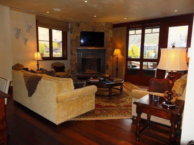 Living room with fireplace and private deck - Solaris 3 Bedroom Premium with King, 2 Queen, and 2 Twin Beds - Vail - rentals