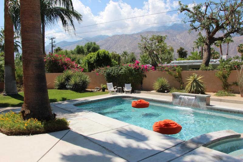 Relax on the beanbag chair floats while basking in the sun under the mountains - Sweet Mid Century Pad w/ Hot Views! - Palm Springs - rentals